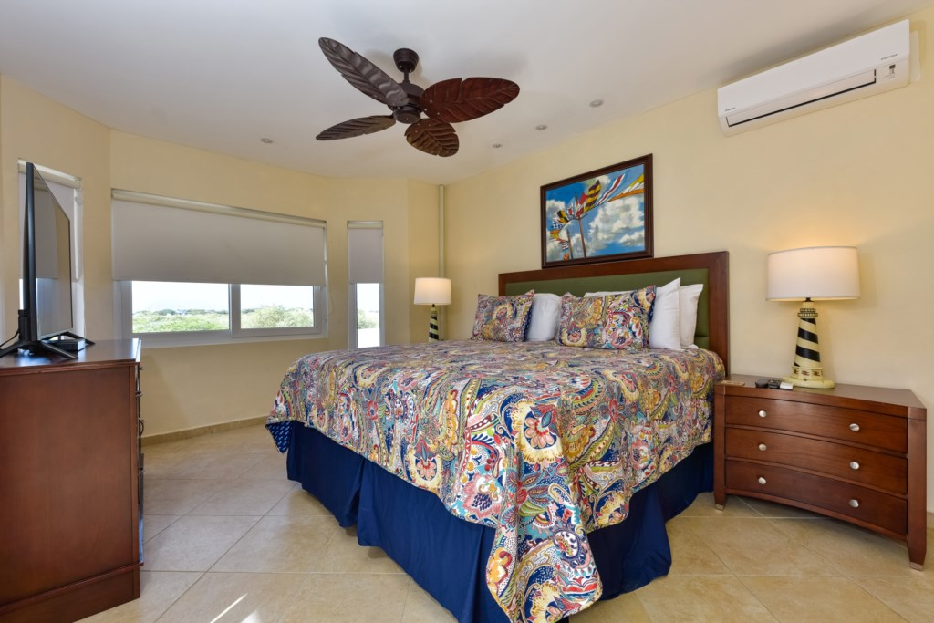 The bedroom with queen size bed, shared walk-in closet, TV and air conditioning. Amazing views!!