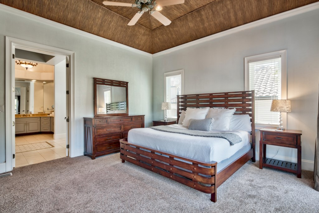 Master Suite with bamboo ceiling & crown molding with indirect lighting!