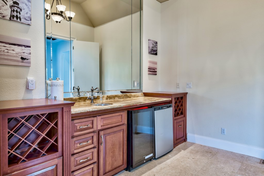 Wine cooler, mini fridge, sink, and custom wine storage