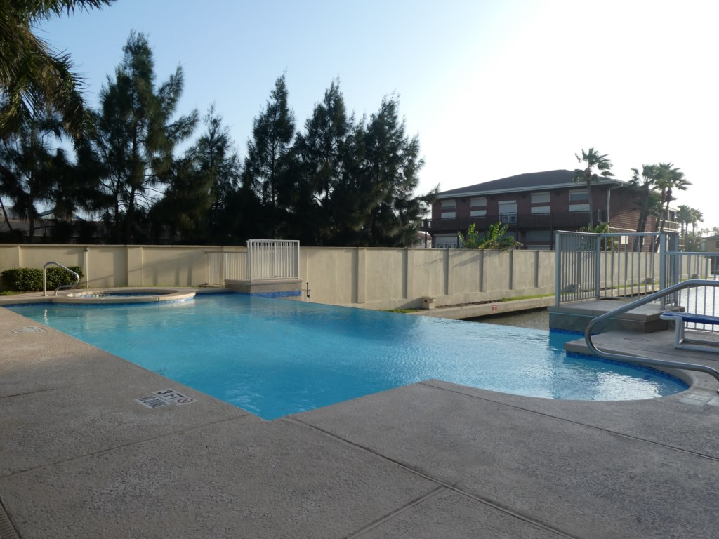 Spacious Pool Deck with Lounges