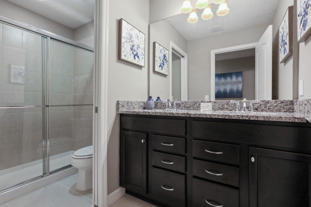 Outstanding double sink vanity with sliding glass shower and toilet