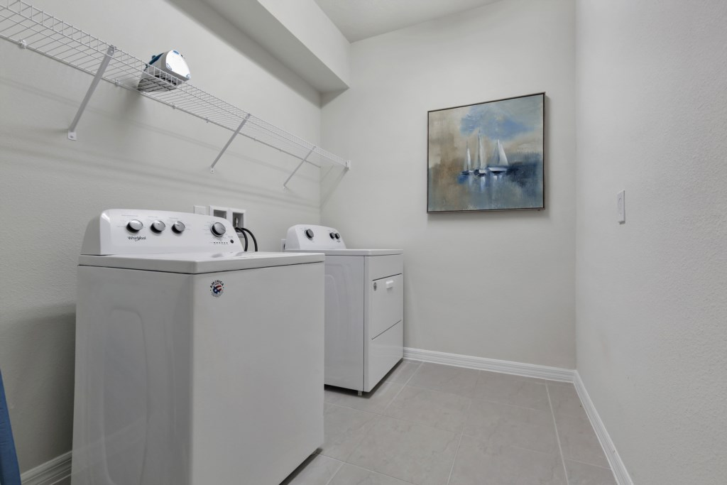 Convenient laundry room with full size washer and dryer