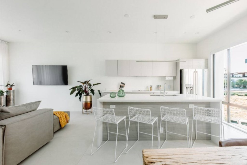 Full kitchen with stainless steel appliances and bar seating