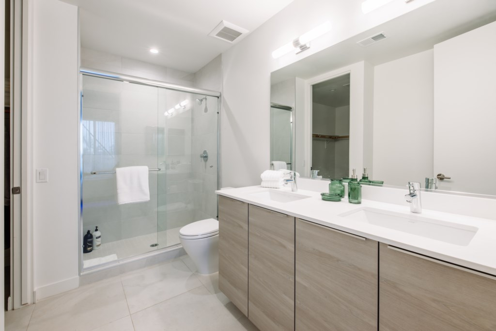 Bathroom with huge walk-in shower and double vanity
