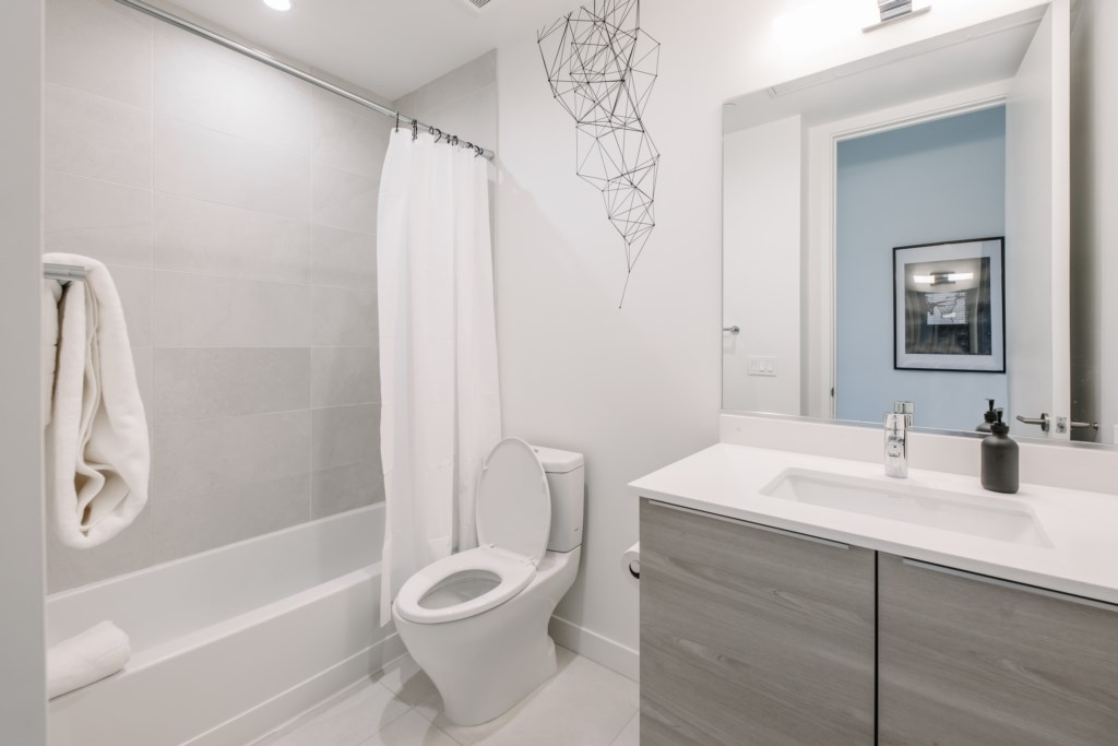 Shared bathroom with shower and tub combo