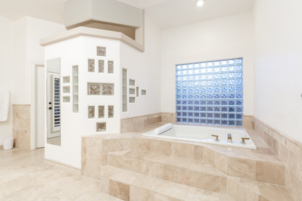 Master Bathroom with large soaking tub and walk-in shower