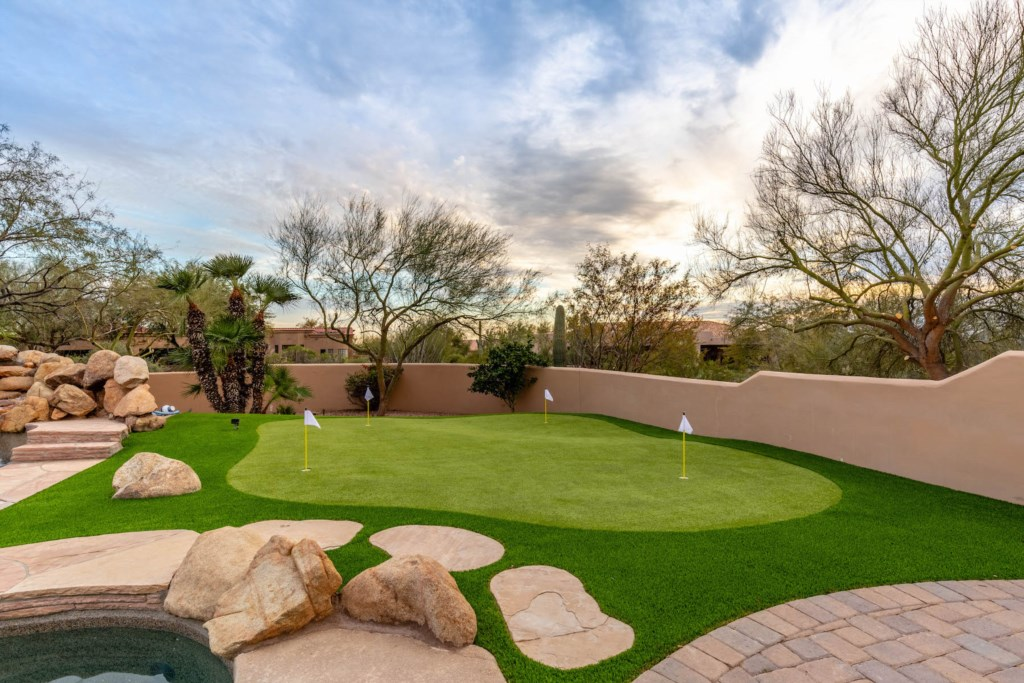 Incredible backyard with pool and putting green