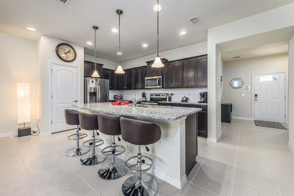 Beautiful modern style kitchen with pantry and barstool seating