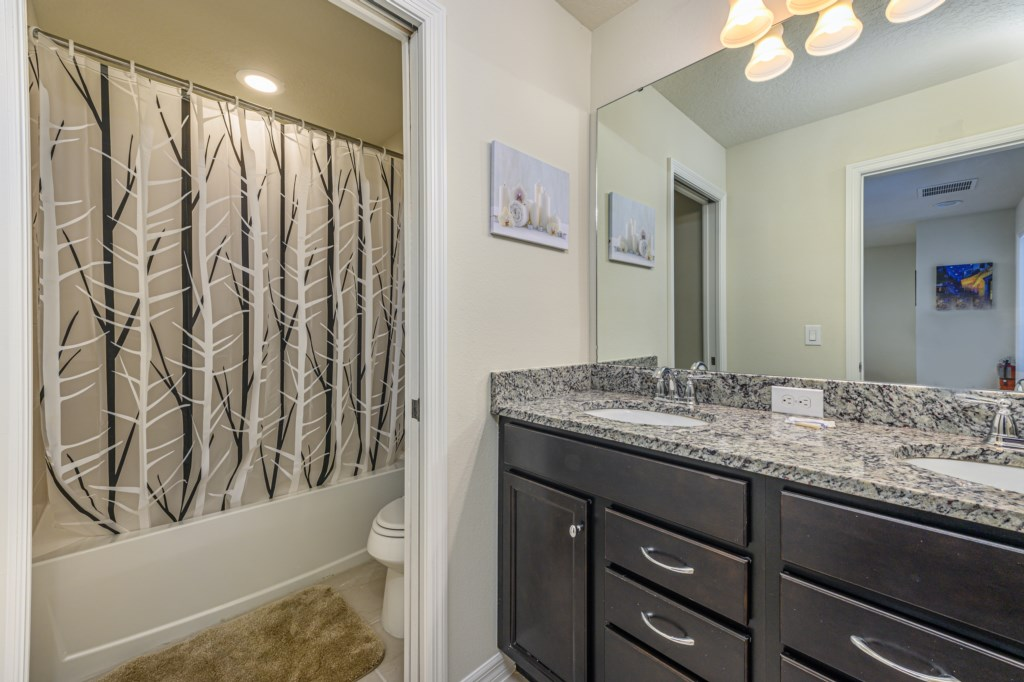 Fantastic double sink vanity and shower with curtain
