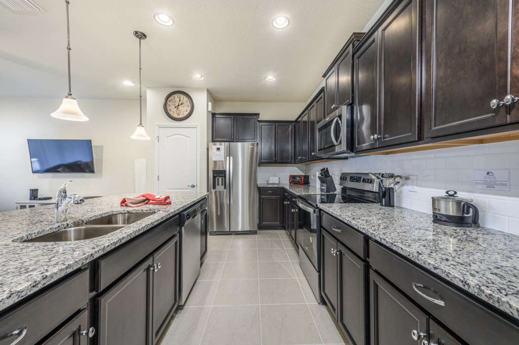 View 3 of beautiful modern style kitchen with microwave, stove, oven, and dishwasher
