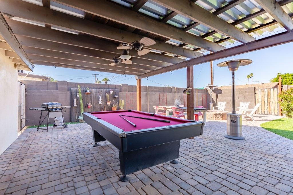 Outside pool table, grill, fire pit and seating