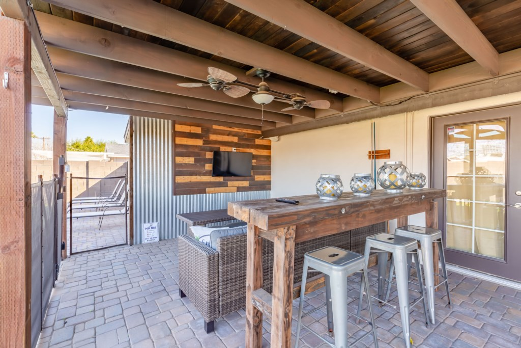 Outdoor seating and flat screen TV