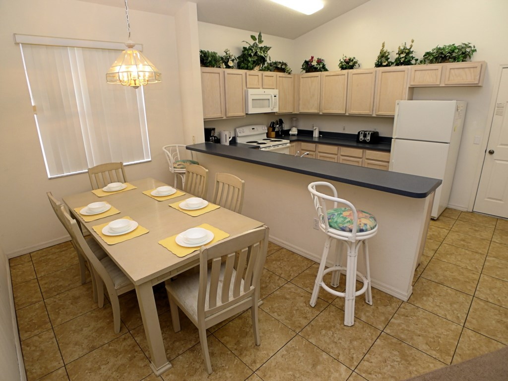 Kitchen Stocked with Amenities and Dining Table Seats 6
