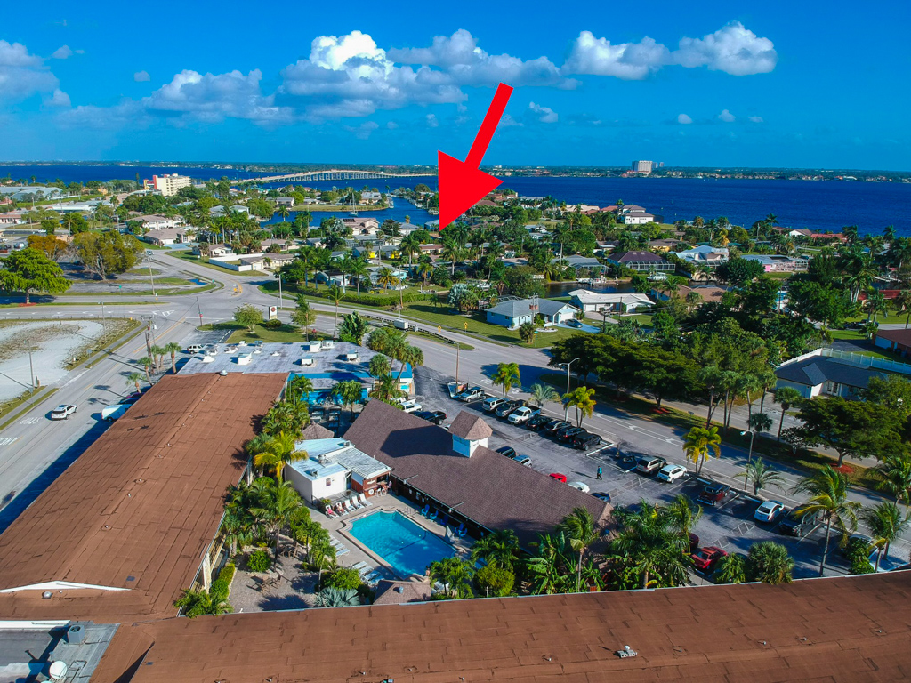 The red arrow is where the house is located and it's proximity to the Tiki Hut