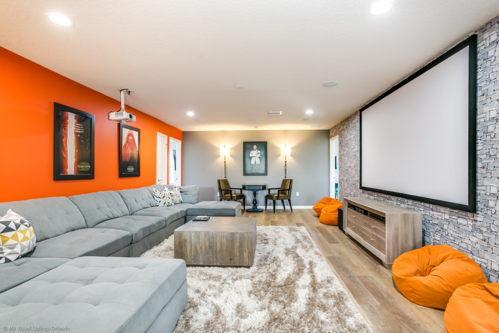 Stunning movie room with projection screen and comfortable sofa