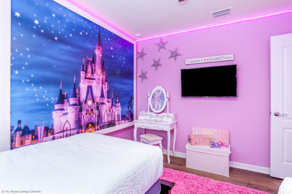 View 2 of adorable Disney princess theme room with two twin sized beds and flat screen TV