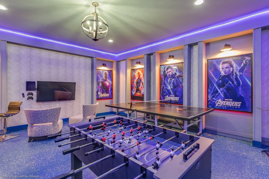 Amazing arcade room with game consoles, foosball, ping pong table, and air hockey