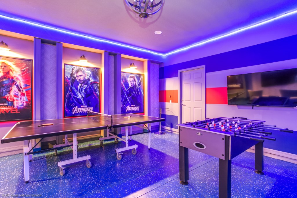 View 3 of amazing arcade room with game consoles, foosball, ping pong table, and air hockey