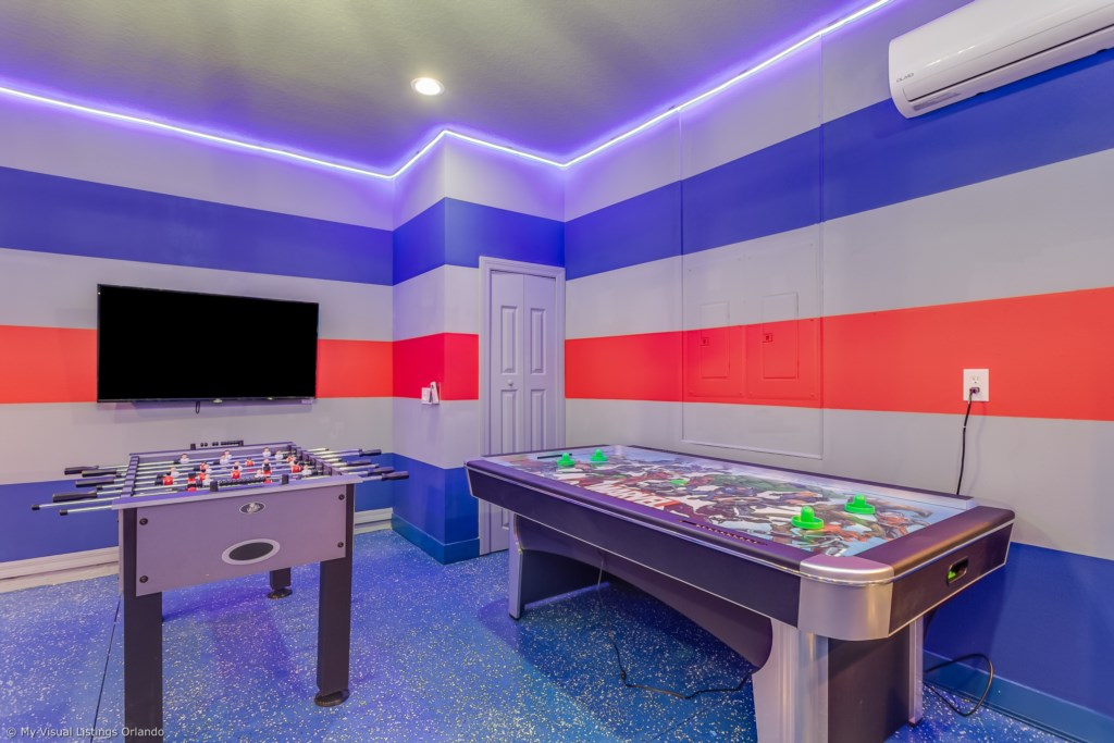 View 5 of amazing arcade room with game consoles, foosball, ping pong table, and air hockey