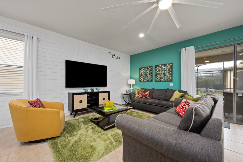 Awesome living room area with comfortable seating and flat screen TV