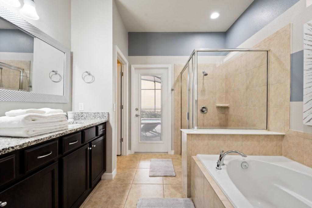 Delightful master bathroom with tub, shower, and double sink vanity