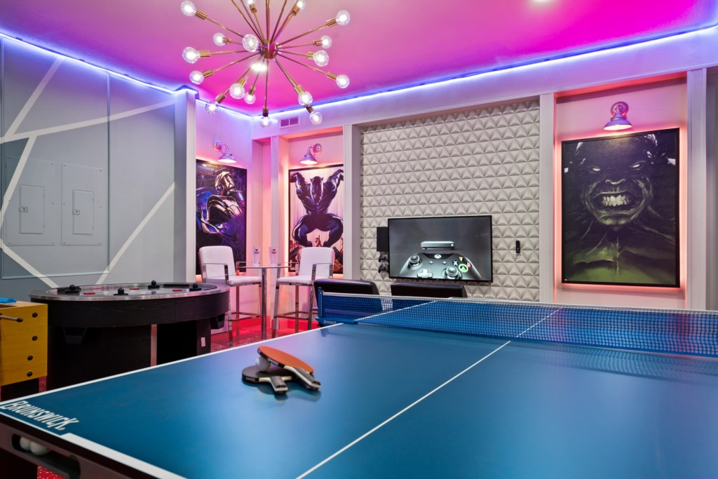 Amazing Marvel themed game room with ping pong, air hockey, and flat screen TV