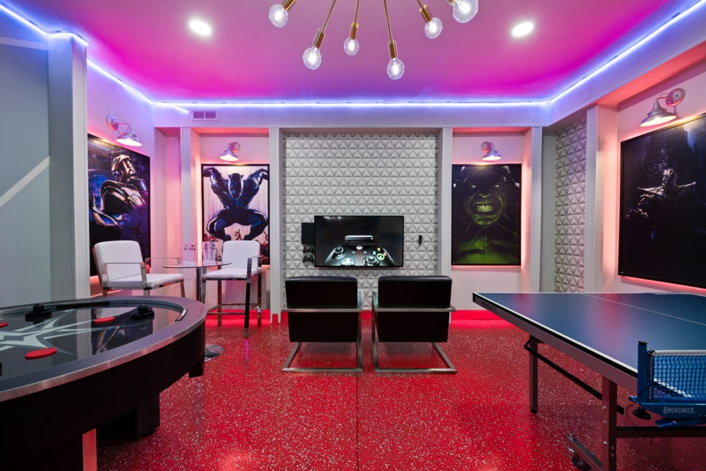 View 2 of amazing game room with ping pong, air hockey, and flat screen TV