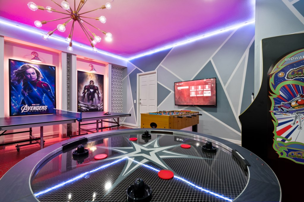 View 5 of amazing game room with ping pong, air hockey, and flat screen TV