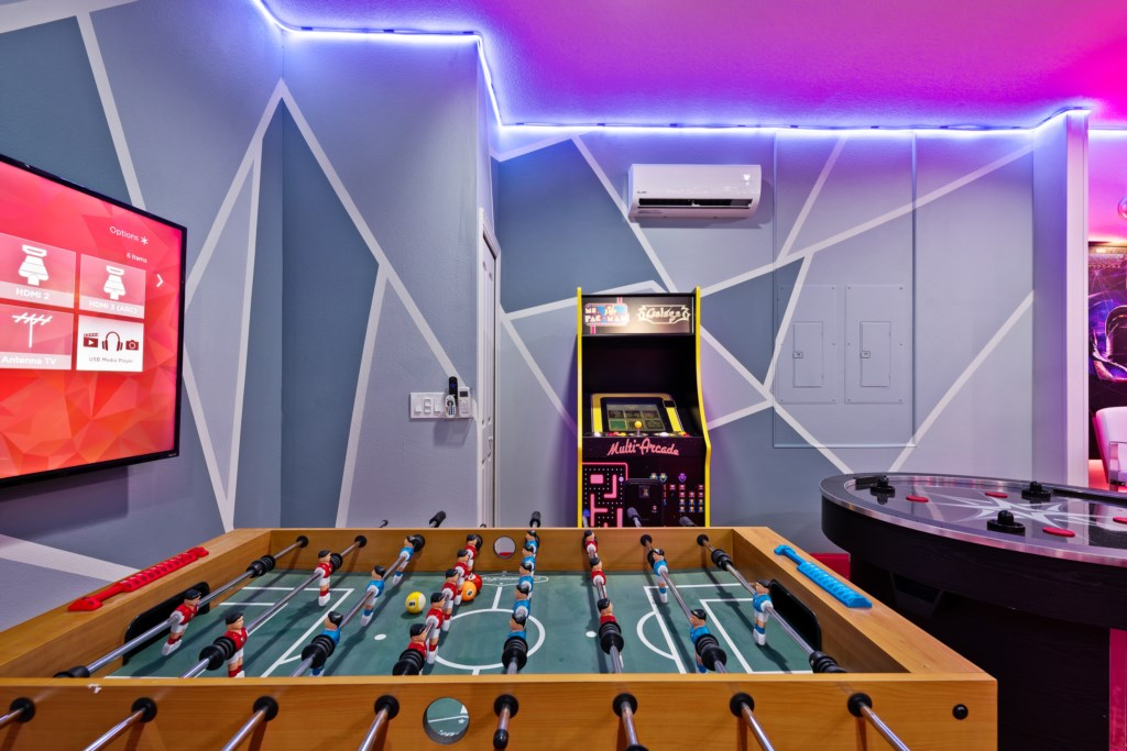 View 6 of amazing game room with foosball and mutli-arcade machine