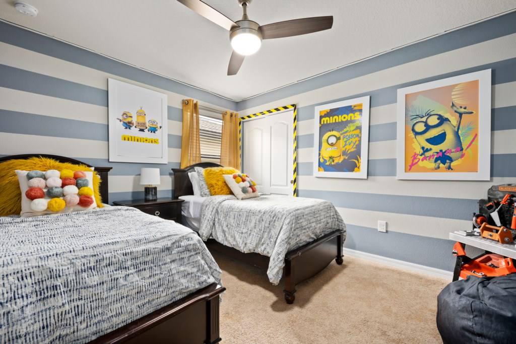 Exciting Minion themed twin beds with flat screen TV