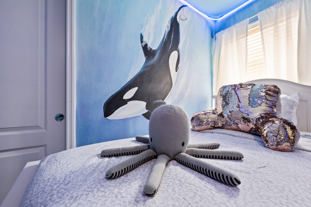 Adorable ocean themed 2 twin beds with flat screen TV