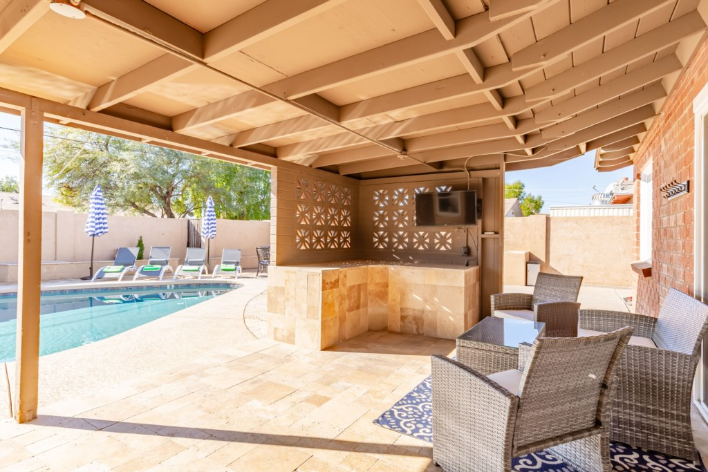 Covered patio with seating and large flat screen