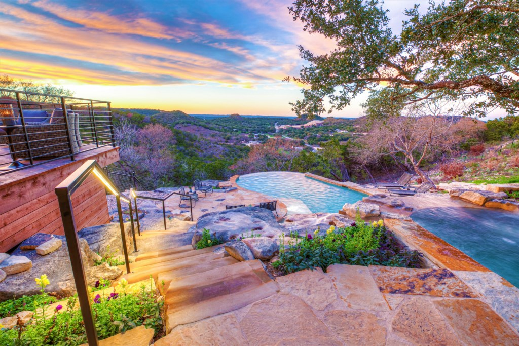 Relax and enjoy the view from our outdoor hot tub and the gorgeous pool!