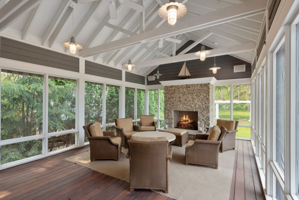 Screened-in porch with gas fireplace