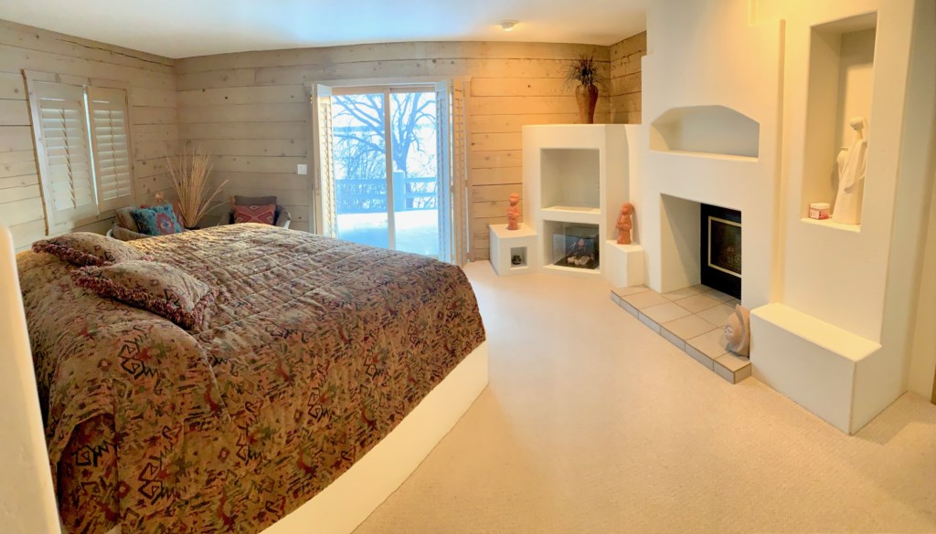 More Santa Fe flair in this king sized bedroom with outdoor access.