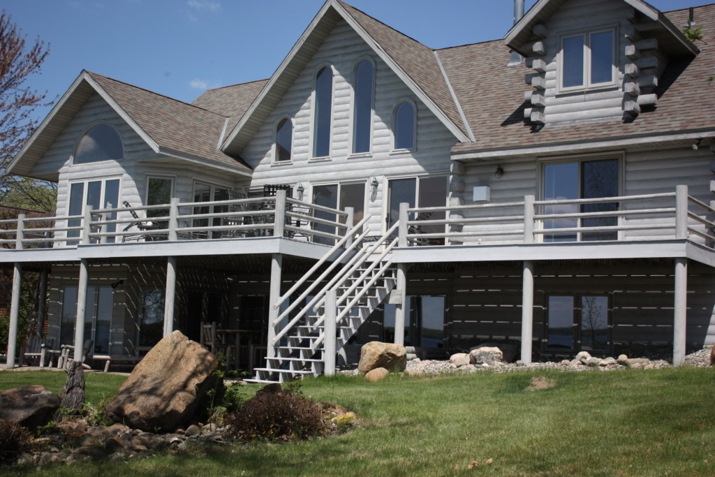 This remarkable lakeside deck runs the full width of the home.