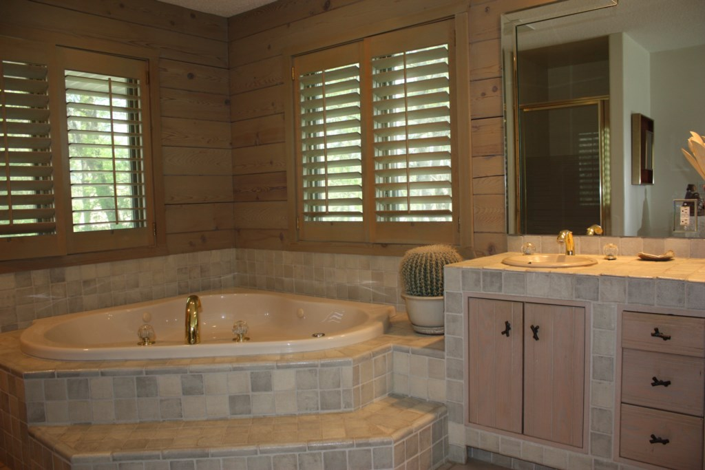 Soak all your troubles away in this large soaking tub.