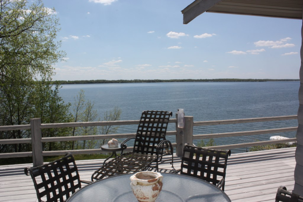 This lakeside deck runs the full width of the home.