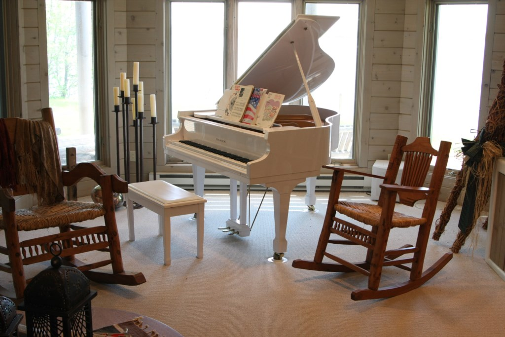Baby grand piano to entertain your friends and family.