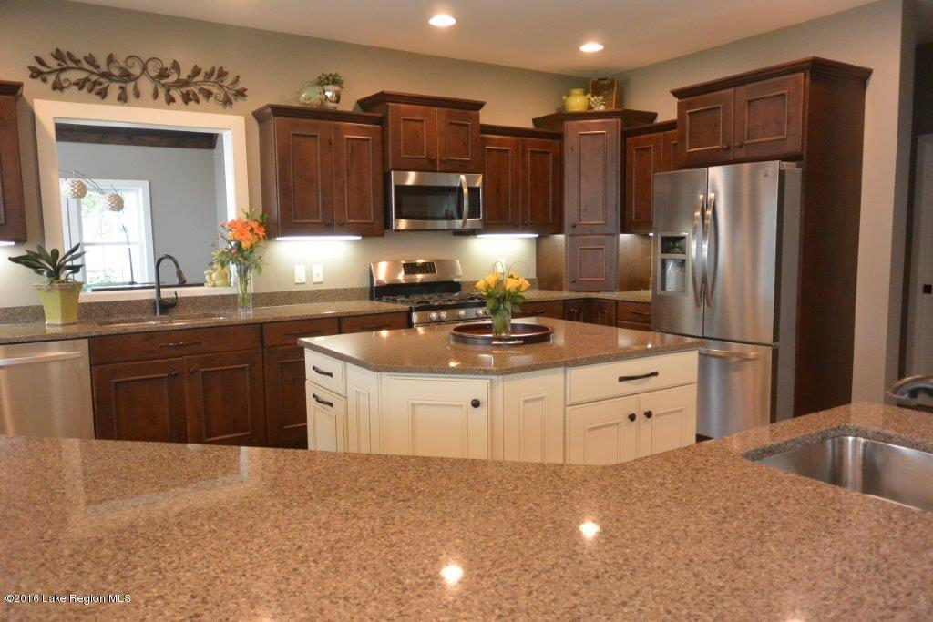 Granite double islands make entertaining a breeze in this beautiful home.