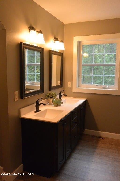 Dural vanities make getting ready for the day a breeze in this custom home.