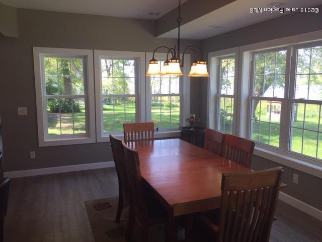 Make your memories here in this gorgeous dining room with vast windows and views of the lake.