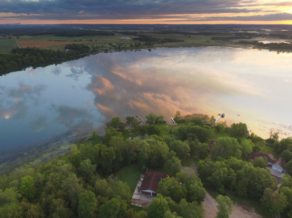 The wooded shoreline of pristine Long Lake offers vacationers the seclusion they need to relax and e