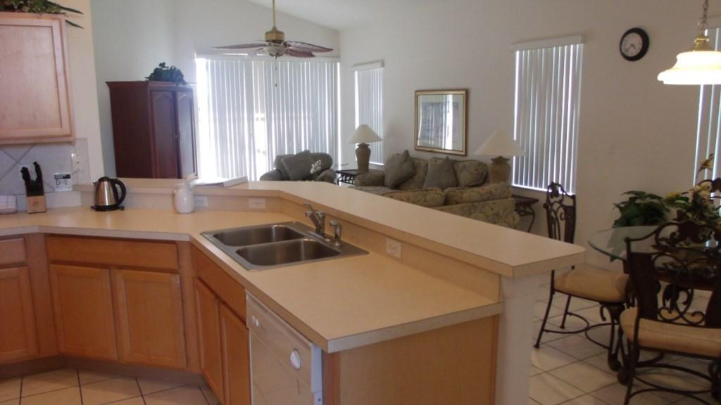 Kitchen Overlooking Breakfast Nook and Living Room