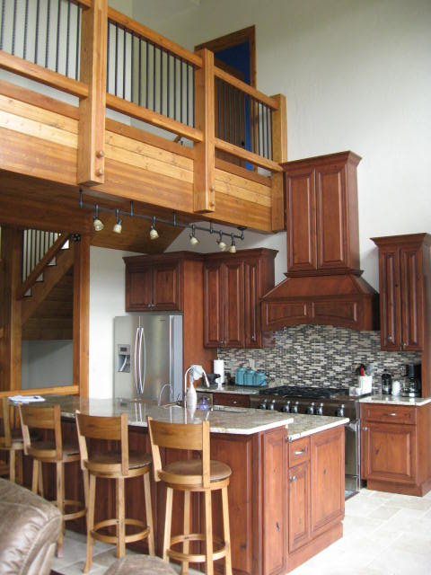 Spacious Wood and Granite Kitchen