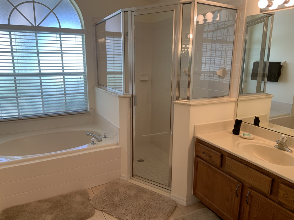 Master ensuite bathroom with separate shower