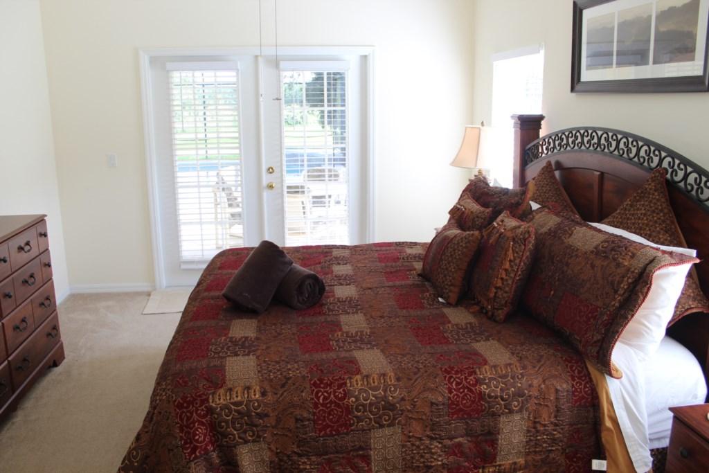 Master king bedroom with patio doors to pool deck