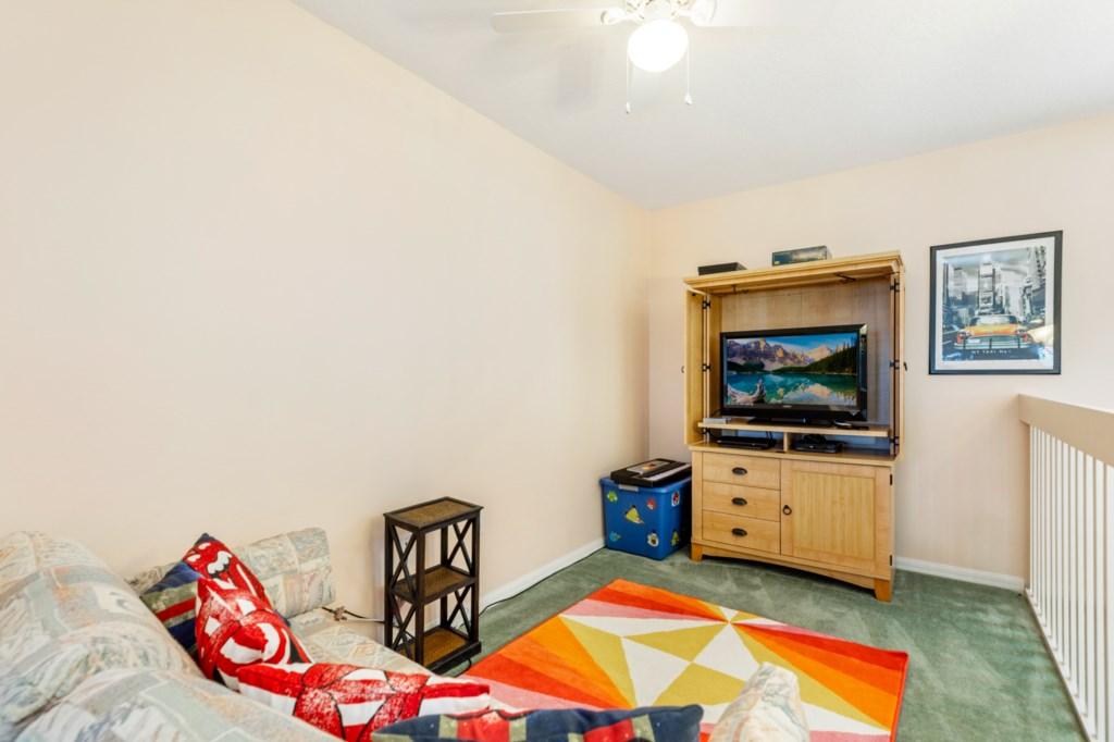 Upstairs loft area with tv