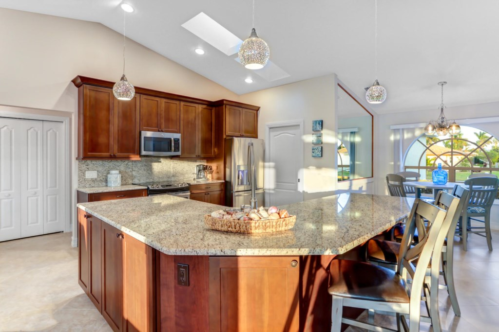 Fully furnished kitchen with granite counters and skylight