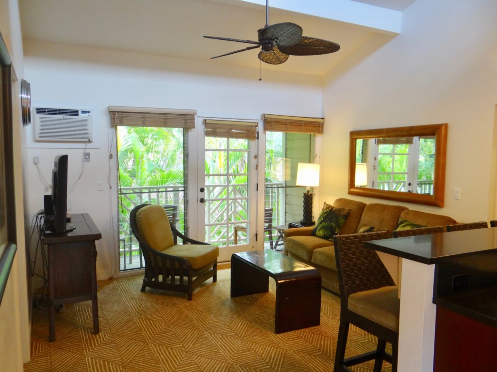 Comfortable living room with access to your private lanai.